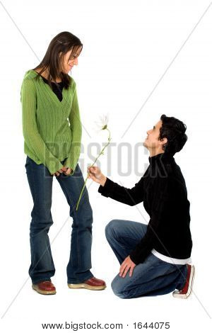 Casual Man Offering A Flower To A Girl