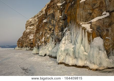 Beautiful icicles on rocks. Winter landscape in the Lake Baikal.