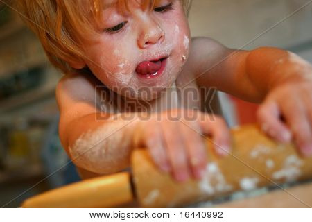 toddler helping in kitchen