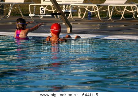 adult teaching child to swim