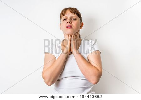 Woman With Throat Sore Is Holding Her Aching Throat