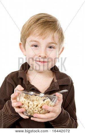 Young boy holding a bowl of cereal