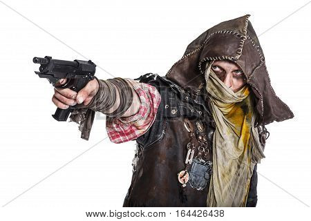 Nuclear post apocalypse life after doomsday concept. Grimy survivor with homemade weapons aiming a gun. Studio closeup portrait on white background