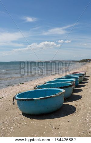 nautical fishing coracles on coast tribal boats at fishing village in vietnam