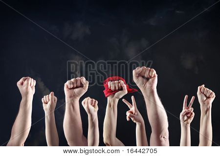 Clenched fists raised in protest