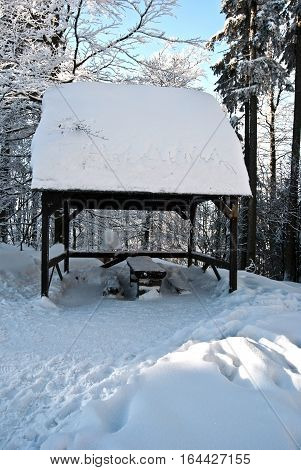 shelter on Luksinec bellow Lysa hora hill in Moravskoslezske Beskydy during sunny winter day with snow