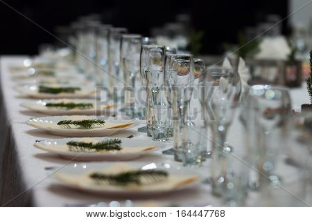Festive table in the restaurant. Table appointments for the new year. Elegant table appointments in the cafe