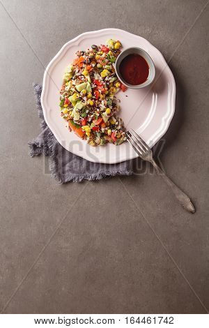 Quinoa Salad With Corn, Tomatoes, Avocado, Pink Sauce On A Plate