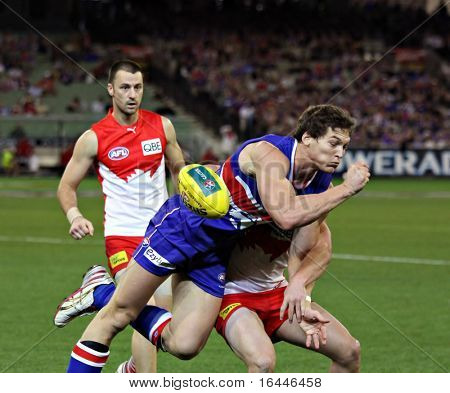 MELBOURNE - SEPTEMBER 12: Will Minson is tackled in the AFL second semi final - Western Bulldogs vs Sydney Swans, September 2008