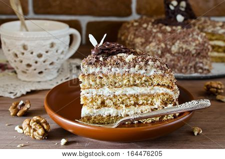 Sweet homemade honey cake with with walnuts and grated chocolate