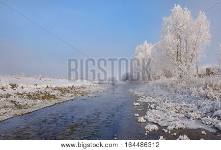 Winter river on a sunny day in Brasov Romania