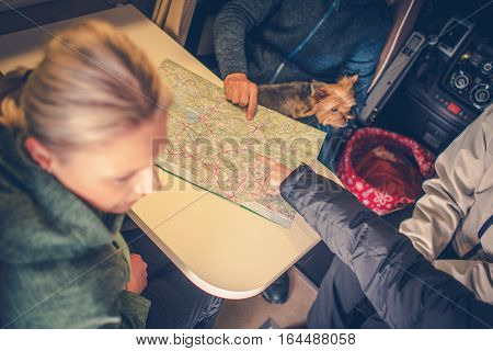 New Camper Trip Planning. Family Planning Next Camper Trip Using Paper Map.
