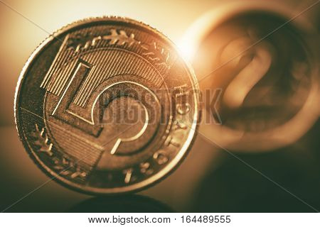 Polish Zloty Coins Closeup. Five and Two Zloty Metal Coins Macro Photo. Polish Currency.