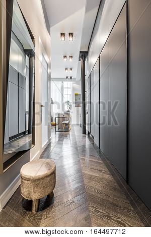 Corridor With Mirror And Stool
