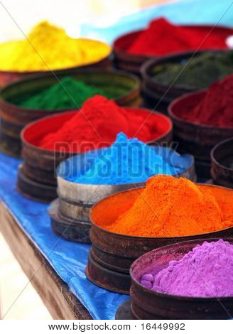Colored powders at market in Pisac, Peru
