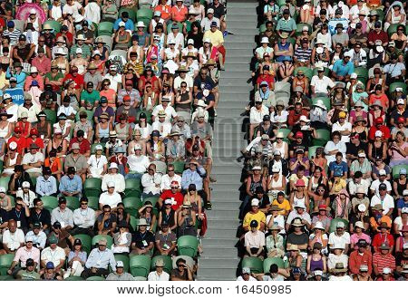 MELBOURNE, AUSTRALIA - JANUARY 27: Crowd watch a tennis game at the 2010 Australian Open at Rod Laver Arena on January 27, 2010 in Melbourne, Australia