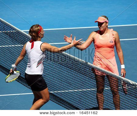 MELBOURNE, AUSTRALIA - JANUARY 24: Russian Nadia Petrova (R) is congratulated by Svetlana Kuznetsova after their fiurth round match at the Australian Open on January 24, 2010 in Melbourne, Australia