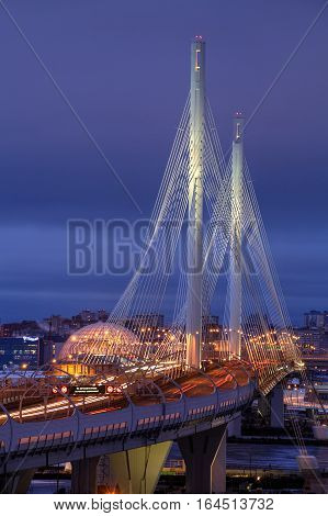 St. Petersburg Russia - December 28 2016: Top view illuminated highway bridge at night in winter cable-stayed bridge over Petrovsky Fairway as part of Western High Speed Diameter vertical photo.