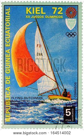 MOSCOW RUSSIA - January 09 2017: A stamp printed in Equatorial Guinea shows yachting the race in Flying Dutchman class series
