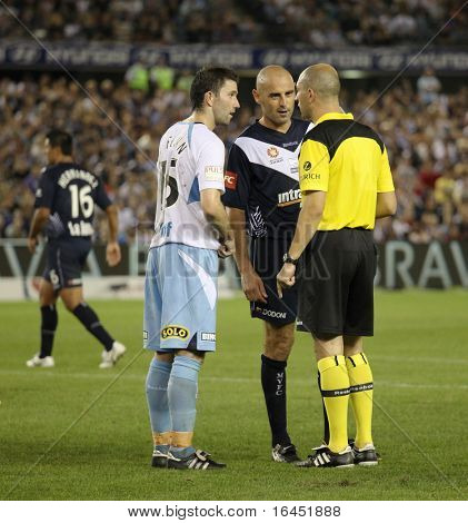 MELBOURNE - MARCH 20: Terry McFlynn (L) & Kevin Muscat argue with ref in the  A-League League grand final won by Sydney FC over Melbourne Victory on March 20, 2010 in  Melbourne.