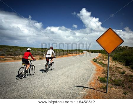 Blank road sign and bicycles
