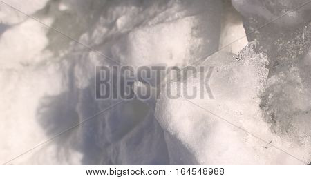 Clumps of snow pile making design background
