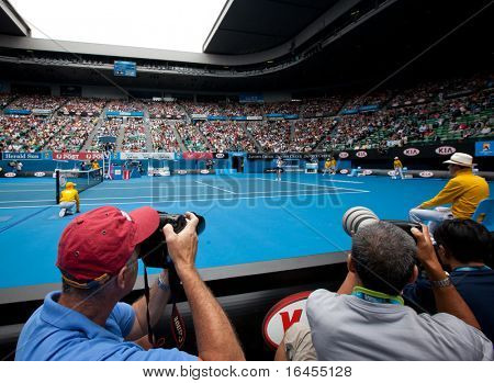 MELBOURNE, AUSTRALIA - JANUARY 25: Photographers shooting the tennis at the Australian Open, January 25, 2011 in Melbourne, Australia
