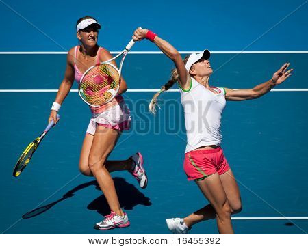 MELBOURNE, AUSTRALIA - JANUARY 28: Maria Kirilenko of Russia (R) with partner Victoria Azarenka of Belarus play in the women's doubles final won at the Australian Open on January 28, 2011 in Melbourne, Australia.