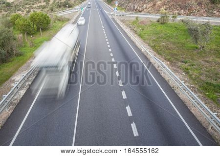 Truck moves at spanish national road with slow vehicles lane. Cerro Muriano Cordoba