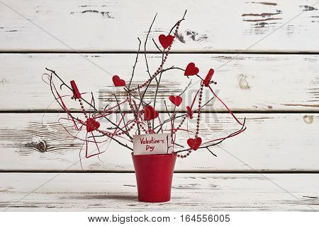 Tree branches and fabric hearts. Branches and bead garland. Decorate room for Valentine's Day.