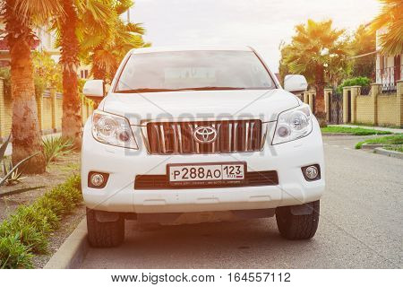 Sochi, Russia - October 11, 2016: New Toyota Land Cruiser in sunlight luxury japanese auto parked on the street of Sochi City.