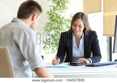Happy professional agent and customer calculating budget at office
