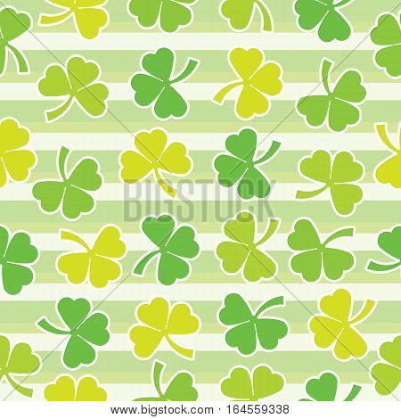 Seamless background of St. Patrick's Day illustration with colorful shamrock leaves on stripes background suitable for St. Patrick's Day wallpaper, scrap paper and postcard