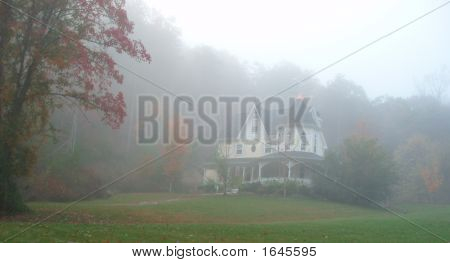 Victorian House Bathed In Fog