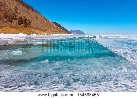 Growers Ice Iceberg In Turquoise Water Of Lake Baikal