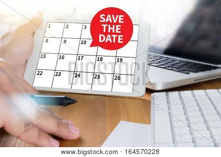 Save The Date Message On Hand Holding To Touch A Phone, Top View, Table Computer Coffee ,