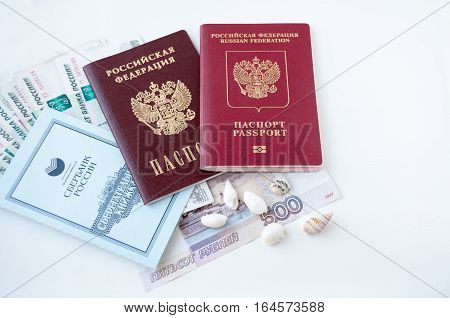 Documents And Shells Lie On The Money. The Concept Of Savings On Travel  Документы и ракушки лежат н