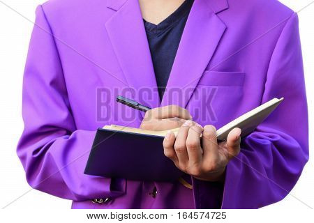 Businessman with notepad in hands signing documents on white background