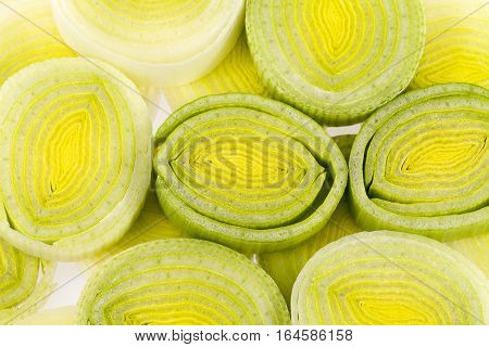 Background of sliced leek rings close up.