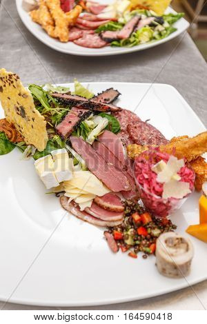 Assorted fresh cold cut platter served on restaurant table