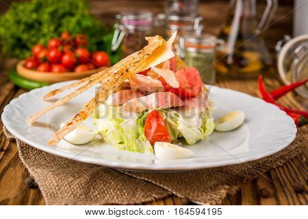 Salad greens with bacon, parmesan cheese, bread, lettuce, bacon parmesan cheese
