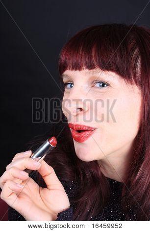 Redhead Holding Lipstick Tube