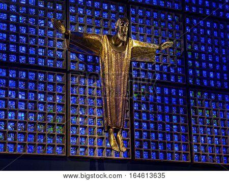 Berlin, Germany - January 16, 2014: Interior of Kaiser Wilhelm Memorial Church (modern building). Crucified Jesus Christ, by architect Karl Hemmeter