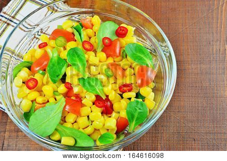 Fresh vegetable salad with corn lamb's lettuce tomatoes chilly and sweet pepper