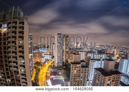 Singapore cityscape view at night from an apartment using fish eye lens