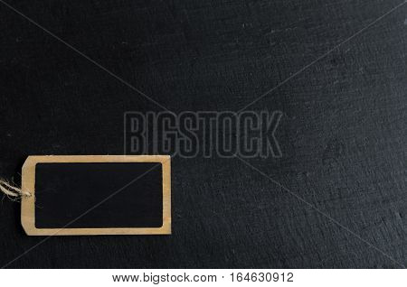 Empty blackboard label for a short message on natural black background copyspace for your text
