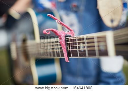 Acoustic Girl Guitar With Capo. Blue Acoustic Guitar.