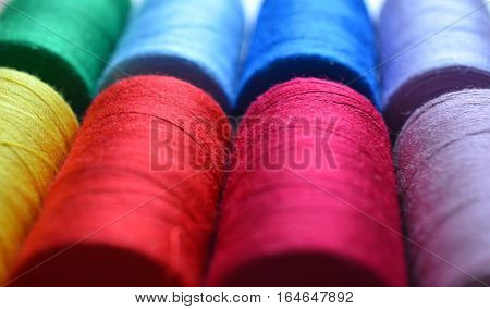 Multicolor sewing threads background - concept of sewing, diversity, rainbow