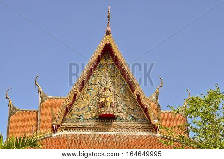 Roof style of Thai temple with gable apex on the top with blue sky