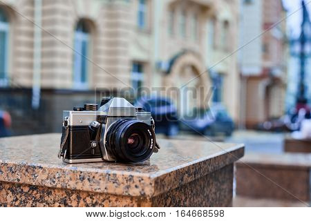 Retro film camera with alloy body and black lens